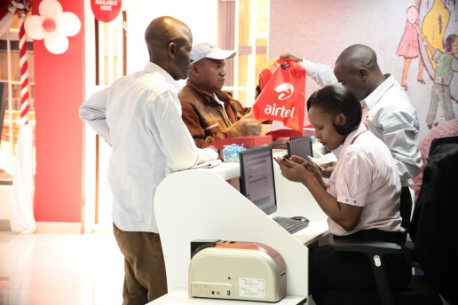 Airtel Customer Service Executived attend to customers at the new Embu shop.