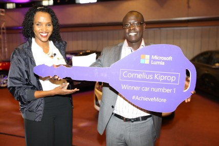 Microsoft Mobile devices GM for East Africa Ms. Mariam Abdullahi with one of the 5 Chevrolet cruze Winner Cornelius Kiprop.