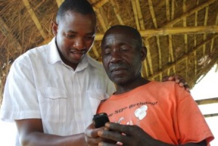 A farmer being taken through WeFarm service and how it works.