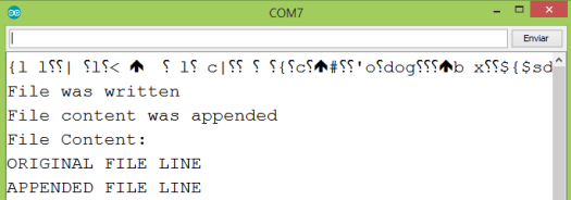 Output of the program on the Arduino IDE serial monitor, showing the file with the original line and the appended one.