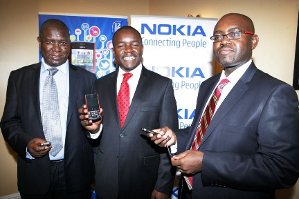 Raymond Michuki of KEBS Kenneth Oyolla General Manager Nokia East and Southern Africa and Stephen Mallowah of the Anti Counterfeit Agency
