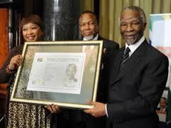 Former president Thabo Mbeki, Deputy President Kgalema Motlanthe and Zinzi Mandela receiving Nelson Mandela's smart ID Card during the launch (image:iol.co.za)