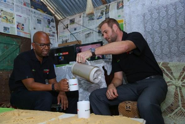 M-Kopa CEO, Jesse Moore (R) and Safaricom CEO Bob Collymore