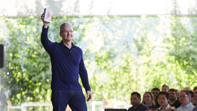 Apple CEO Tim Cook shows off the one billionth iPhone to Apple staff
