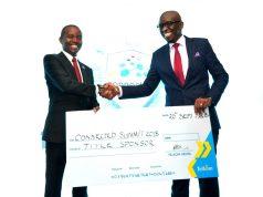 JOE MUCHERU (CS.MINISTRY OF ICT) KRISS SENANU (MD,ENTERPRISE TELKOM KENYA