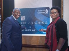 Visa Kenya Country Manager Victor Ndlovu (left) and Standard Chartered B...