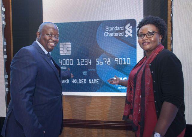 Visa Kenya Country Manager Victor Ndlovu (left) and Standard Chartered B...