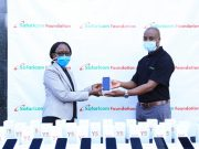 Safaricom Foundation Trustee Steve Chege (right) hands over a mobile device to Renaldah Mjomba, representative of Zizi Afrique Director at Safaricom Headquarters. Safaricom Foundation donated over 70 mobile devices to students who have been shortlisted for the Foundation's Technical, Vocational Education, and Training (TVET) programme.