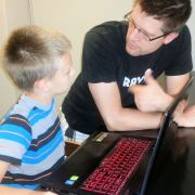 Brandon is helping his son learn about code
