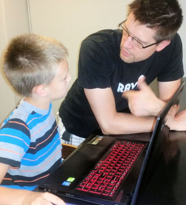 A father and son discuss code