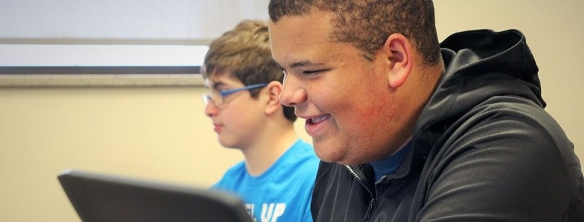 Two teens studying Unity in TechWise Academy class