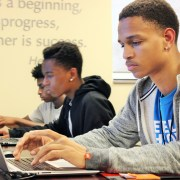Teen typing in code during Unity Class at TechWise Academy