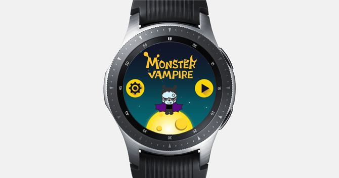 Screenshot of the Galaxy Watch with the Monster Vampire Game. Cute little monster with its wings stretched out on a yellow planet.