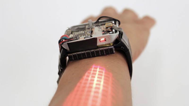 LumiWatch - Relógio inteligente que projeta a tela do dispositivo no seu braço