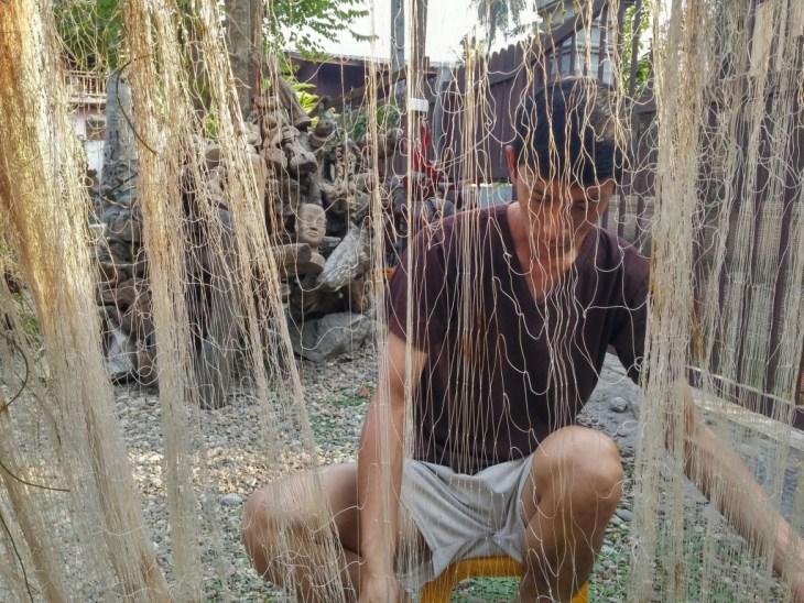 2015-02-16 laos luang prabang net fisherman repairing small