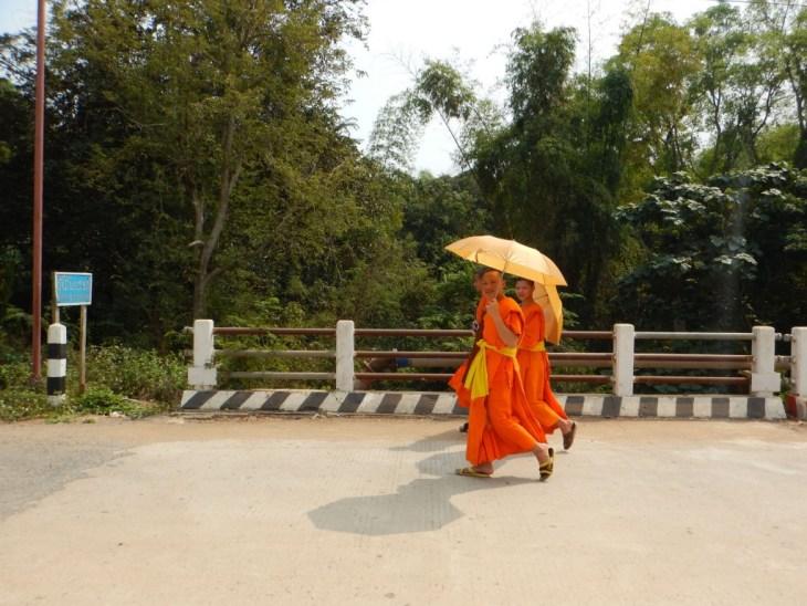 LGV156 laos luang prabang monks walking sabadee copy