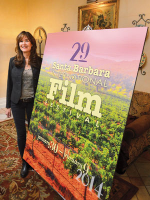 "Barbara Boros unveils the poster for the 29th annual Santa Barbara international Film Festival on Tuesday. ""Exploration"" is the theme"