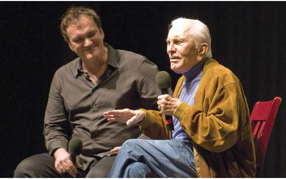 "Quentin Tarantino and Kirk Douglas ask each other questions in front of the crowd after the showing of ""Posse"" at the Lobero Theater. ROBBY BARTHELMESS/NEWS-PRESS"