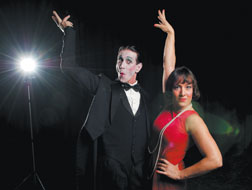 A nameless emcee (Cecil Sutton, left) facilitates the entertainment inside the Kit Kat Klub, which includes the sultry Sally Bowles (Holly Ferguson) in 1930s Berlin, but a growing Nazi party might have something to say about such a place. Photo by Dean Zatkowsky