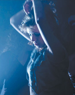 The film's central figure, played by actress Emily Lape, dances the night away in a scene.