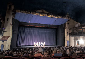 "A 10th anniversary screening of the movie ""Sideways"" was held at the Arlington Theater on Sunday. Attendees take in a question-and-answer session involving, from left, moderator Gabe Saglie, actress Virginia Madsen, director Alexander Payne, Hitching Post owner Frank Ostini and Kalyra Winery owner Martin Brown, also shown below. NIK BLASKOVICH / NEWS-PRESS"