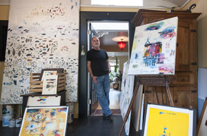Neal Crosbie is taking the weekend off from the Cabrillo Blvd. Arts and Crafts Show to welcome visitors to his studio.