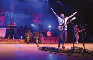Among Persian rugs, potted plants and billows of stage smoke, Santa Barbara band Rebelution finally realized a long-held dream and headlined a concert at the Santa Barbara Bowl on Sunday. MICHAEL MORIATIS/NEWS-PRESS