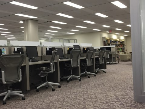 Computer stations near print reference materials at American University's Bender Library.