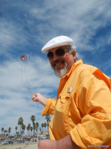 Ron Gibian flies his kite at a kite festival. Photo credit Takaku Barresi.