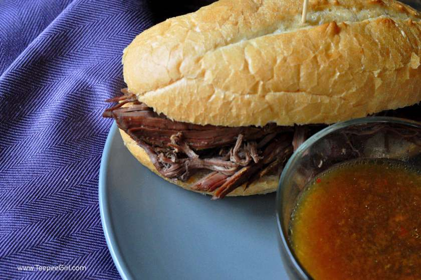 This easy slow-cooker French dip recipe comes together in a snap! It's literally set and forget, and then dinner is done! www.TeepeeGirl.com