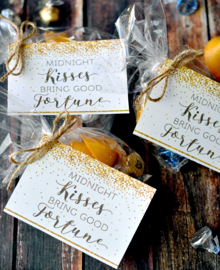 """These New Year's printables make bringing in the new year fun and easy! Just put some chocolate kisses and fortune cookies in a bag with the tag that says """"Midnight kisses bring good fortune!"""" Click here or go to www.TeepeeGirl.com!"""