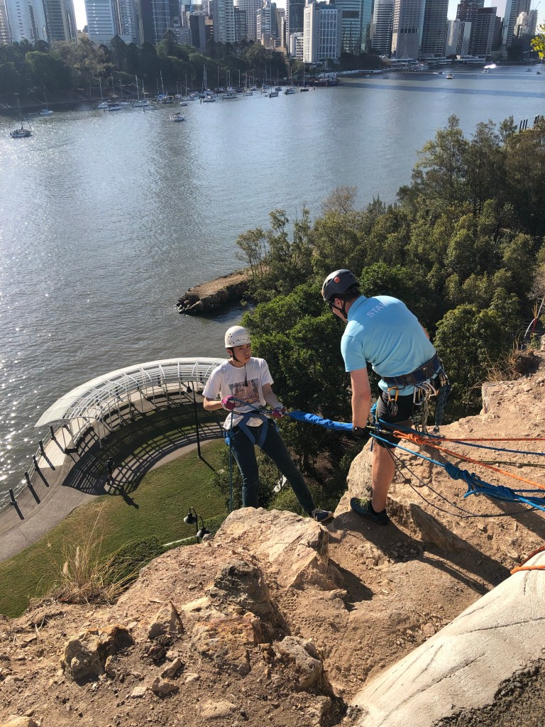 Guy starting to abseil