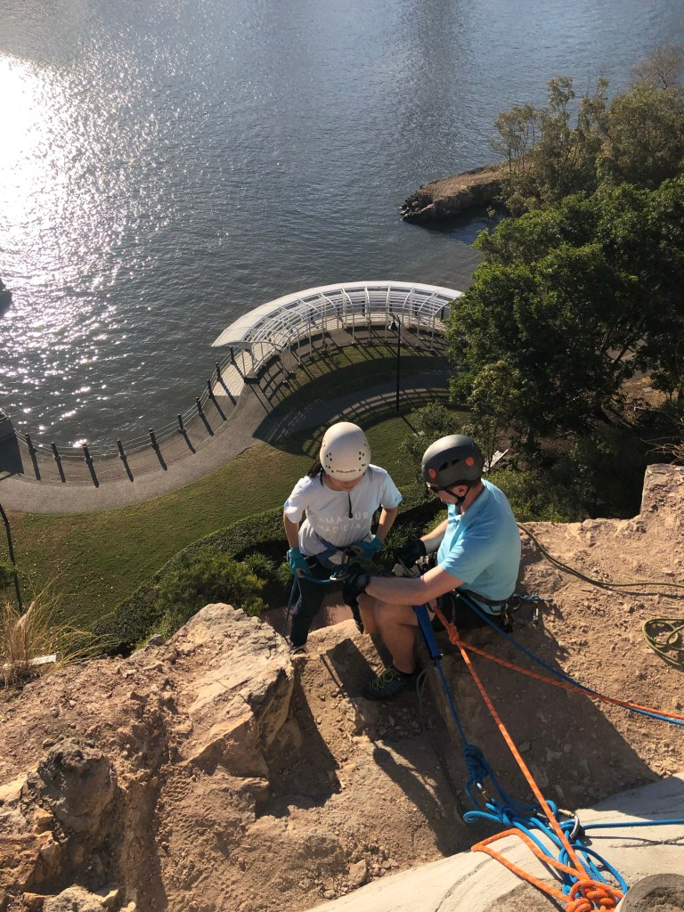 Girl in position to abseil