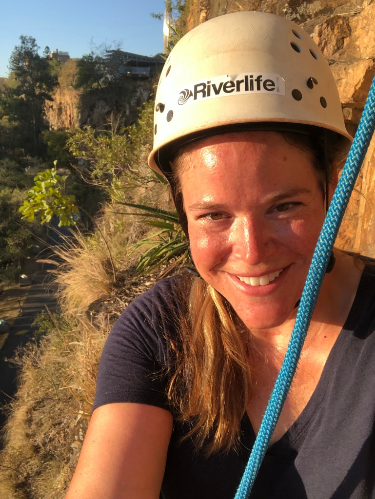 woman on cliff while abseiling