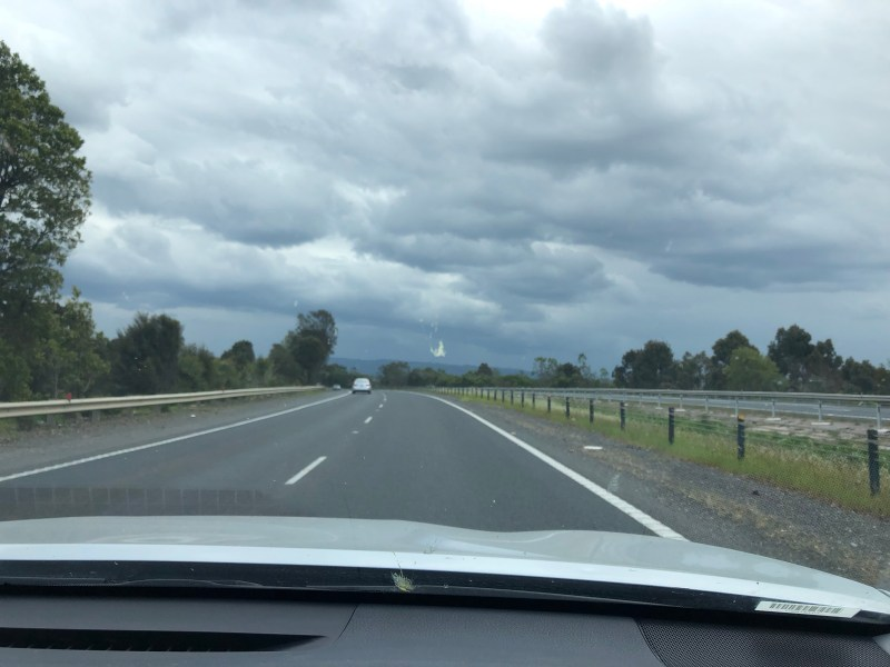 Driving with dark clouds