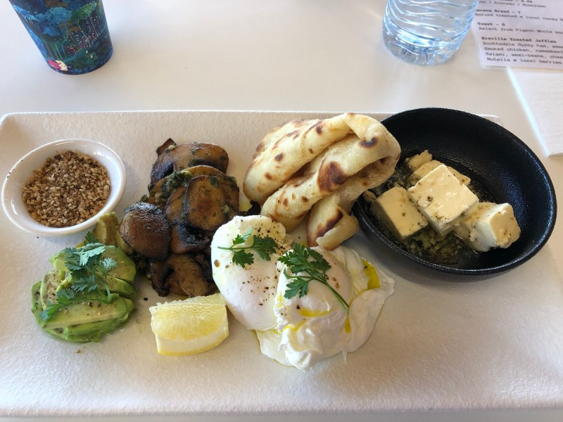 artesian breakfast with eggs, pita bread, mushrooms