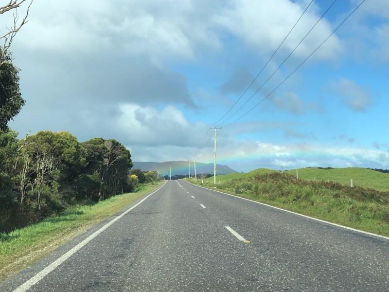 rainbow over green fields