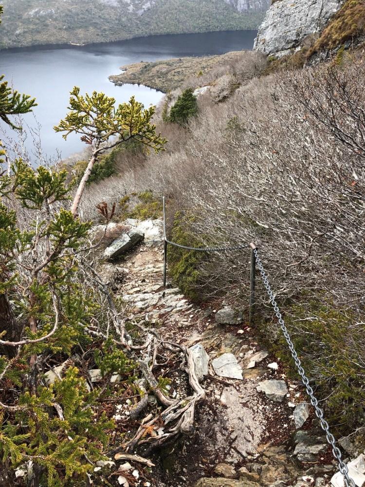 steep rocky trail with chain railing