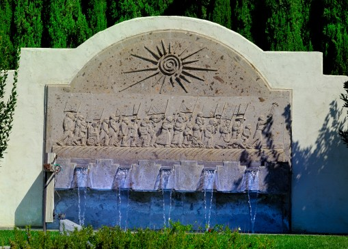 """Memorial fountain with artwork depicting """"Marchers"""""""