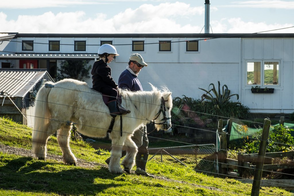 child on small pony at te horo equestrian and farmstay