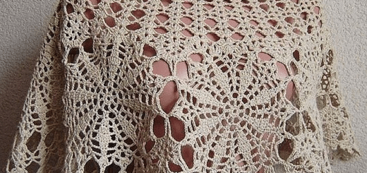 Poncho corto motivo crochet