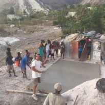 John working on foundation for house in Haiti.