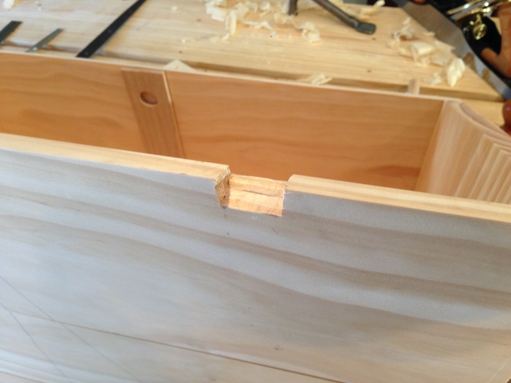 The mortise on the back of the chest that will house the barrel of the hinge.