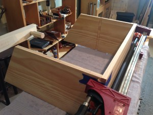 Dovetails are a self-clamping joint but I put a few clamps across the tails to pull things together while it dried.