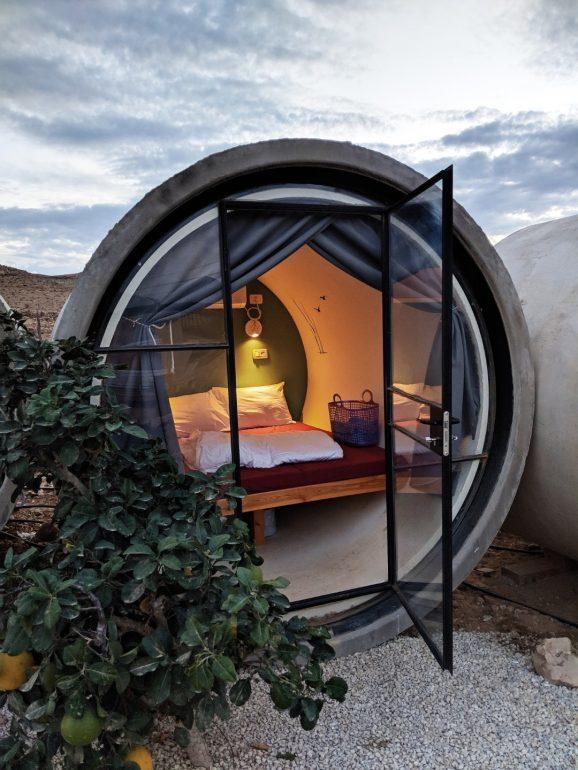 desert capsule hotel concrete tubes israel
