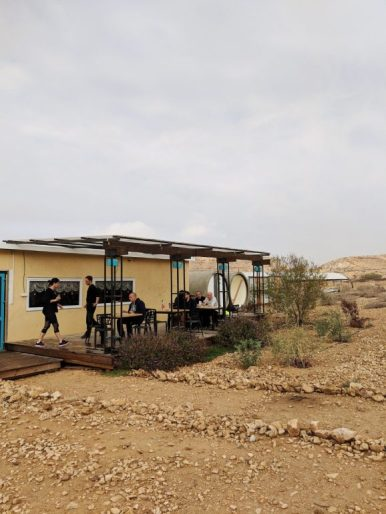 desert capsule hotel concrete tubes israel breakfast