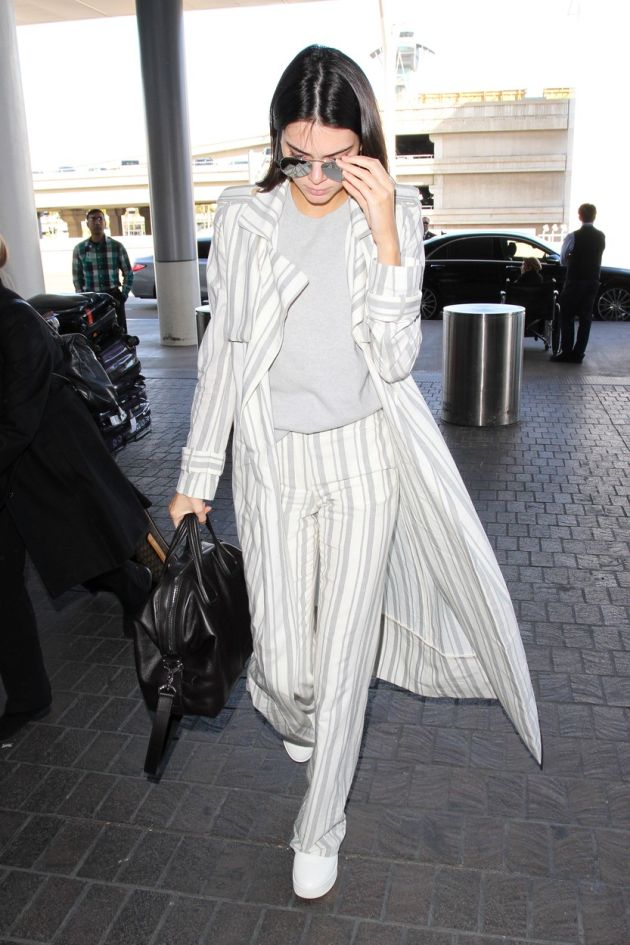 Los Angeles, CA - Kendall Jenner departs LAX to head to fashion week. The model wore striped flares with a matching long jacket and a grey knit top. Kendall changed handbags from earlier at lunch in Weho. January 21, 2016, Image: 271982140, License: Rights-managed, Restrictions: NO Brazil, Model Release: no, Credit line: Profimedia, AKM-GSI