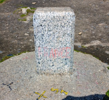 The small stone designating the France / Swiss border.