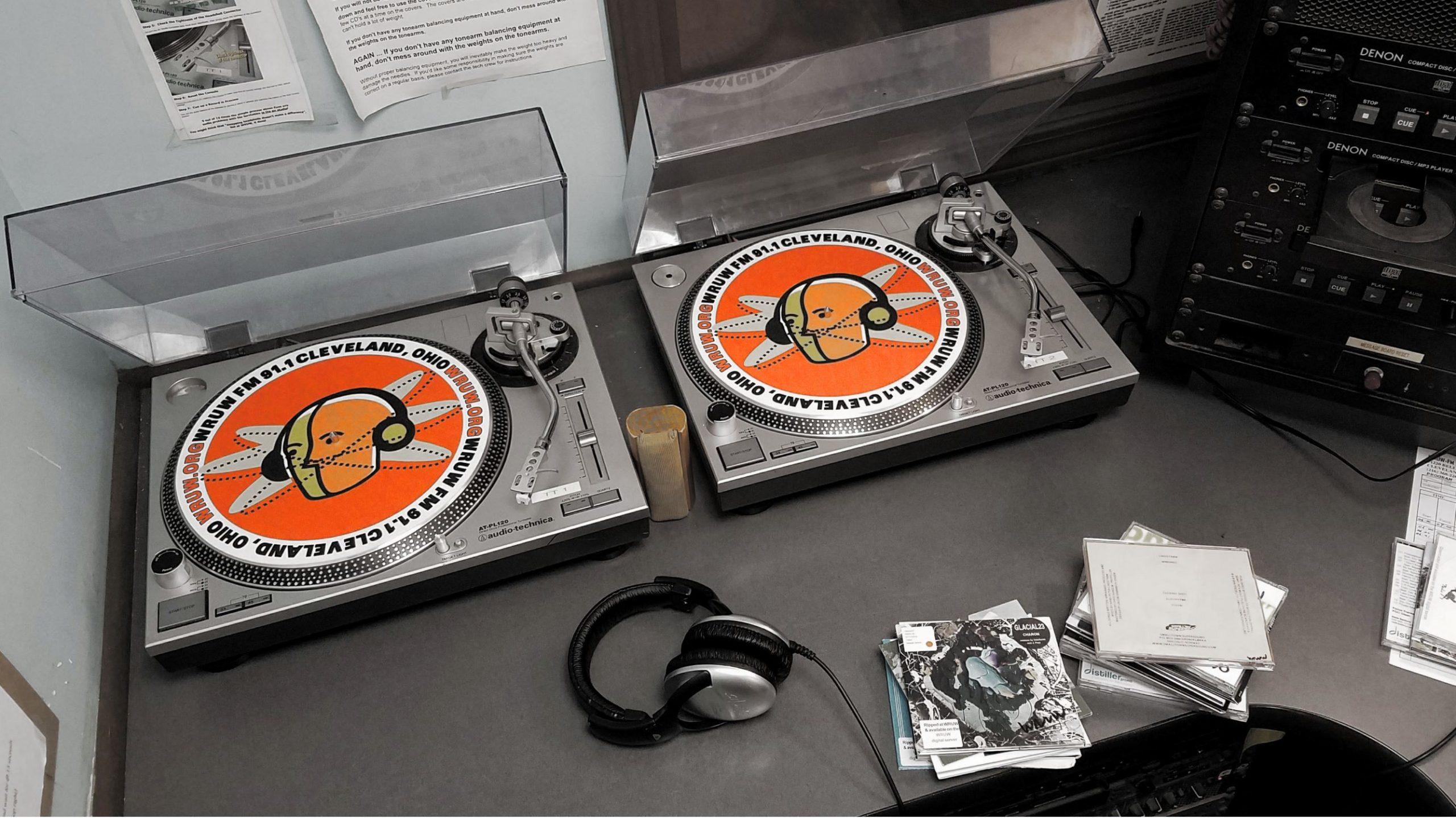 WRUW turntables with visible orange radio head logo