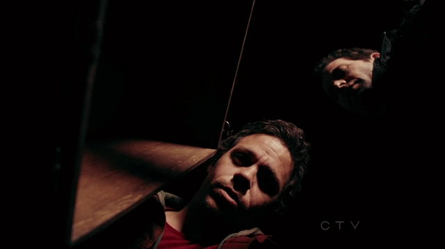 Neal Cassidy (played by Michael Raymond-James) and August Booth (played by Eion Bailey) looking into august's box